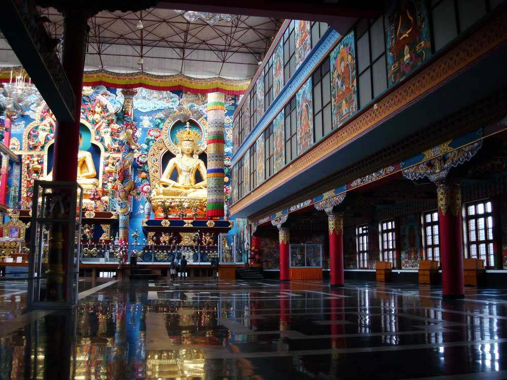 Inside the Namdroling Monastery - To get a sense of how Grand it is inside, look at the tiny people towards the end of the room.